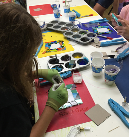 Kids enjoy glass fusing at Arts & Glass